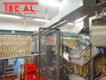 FRANKFURTERS AUTOMATIC LOADING OF CONTINUOUS OVEN